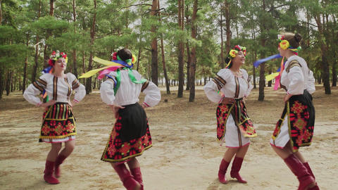 Group of young women in traditional costumes are dancing Ukrainian national Live Action