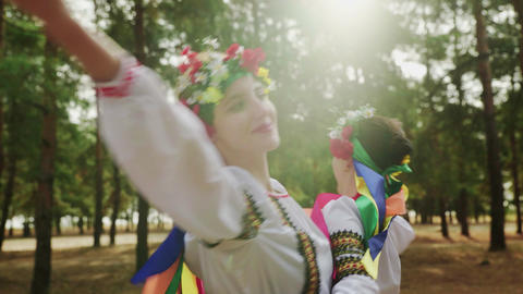 CLose up of two women in traditional costumes are dancing Ukrainian national Live Action