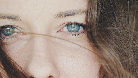 Blue eyes closeup, eyesight of young woman looking away, health care and vision Live Action