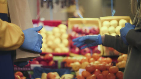 Close up of young couple in blue gloves quarreling at the market Live Action