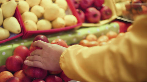 Close up of man chooses a fresh red apples in the market Live Action