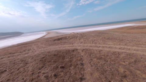Sport fpv cinematic drone close speed flight above wonderful pink Salt lake with Live Action