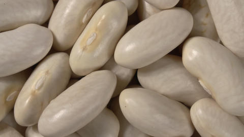 Rotation of white beans close up. Macro. 4K video. Organic legumes Live Action