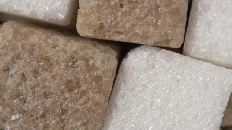 Rotation of sugar close-up. White and brown sugar. Sugar cubes Live Action
