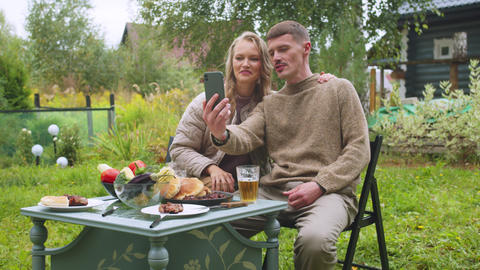 A young couple is going to make a joint selfie about buying a country house on a Live Action