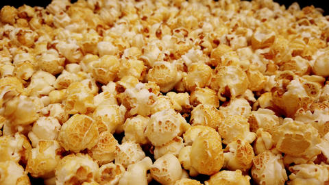 Close up flight over freshly popped popcorn Live Action