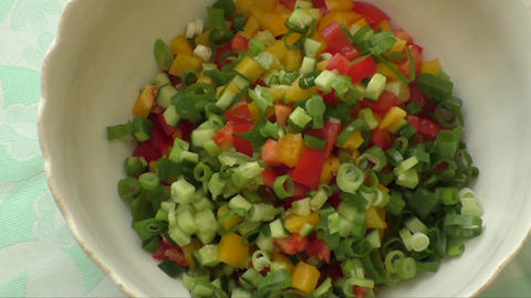 Assorted fresh cut vegetables in a bowl Footage