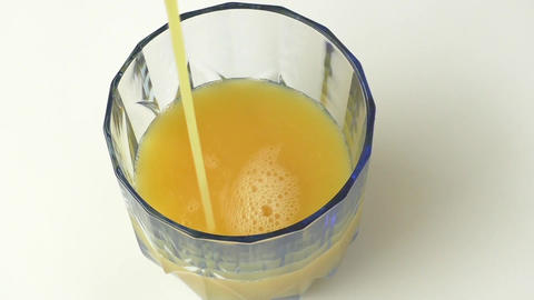Glass of orange juice from above Footage