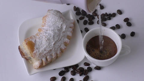 Sweet pastry and cup of black coffee Live Action
