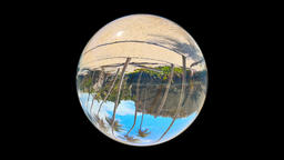 Beautiful Tropical Landscape seen through a Glass Orb, on black, loop Animation