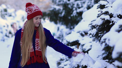 Young woman walking in snow forest Footage