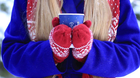 Female hands with hot drink outdoors on winter day Footage
