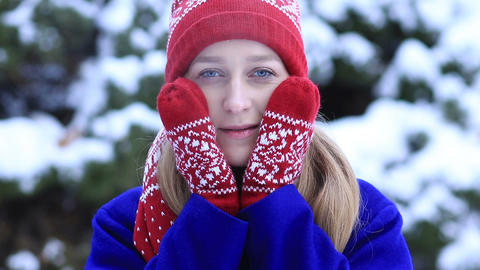Attractive woman freezing outdoors in winter Footage