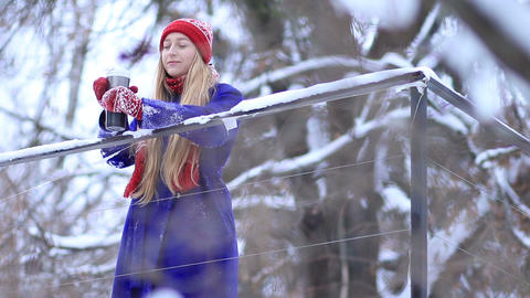 Young woman enjoying winter landscape Live Action