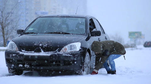 Woman shoveling and removing snow from her car Footage
