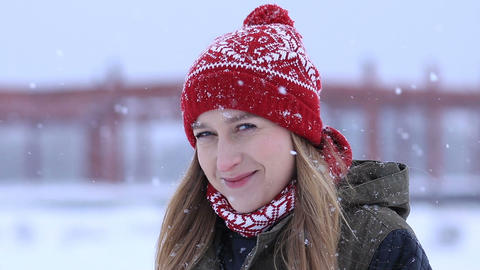 Beautiful blonde woman on a snowy winter day Footage