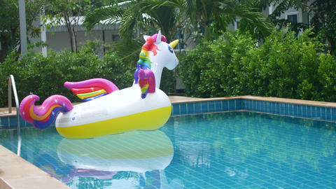 lonely inflatable unicorn swims in an empty pool, tourism crisis Live Action