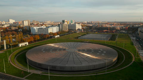 Establishing Shot above Futuristic Velodrome Building cycling Arena in Berlin Live Action
