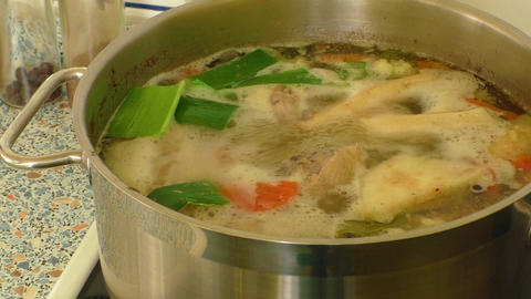 Chicken soup on the stove Footage