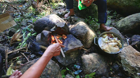 People Cook Food in Pan on Bonfire in Mountain Forest Footage