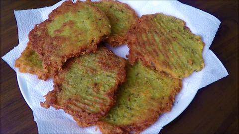 Fried potato pancakes on a white plate Footage