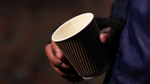Miserable poor man begging for charity donation with paper cup in hands, poverty Footage