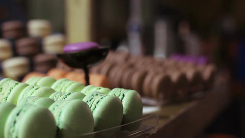 Appetizing colorful macaron sweets at confectionery window, delicious dessert Footage