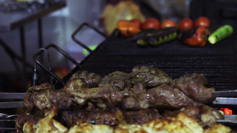 Greasy fried meat on charcoal grill, unhealthy food detrimental to health, BBQ Live Action