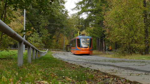 Modern Moscow Tram Rides Through The City Park Live Action