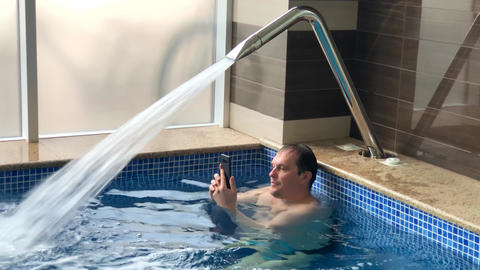 Adult men have rest in pool Live Action