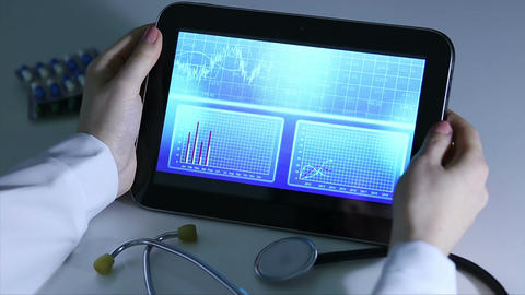 Epidemiologist investigating patterns of disease, comparing statistics on tablet Footage