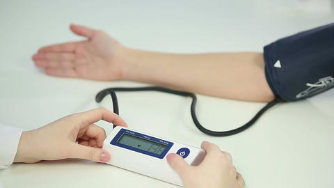 Medical worker monitoring blood pressure of patient diagnosed with hypotension Footage