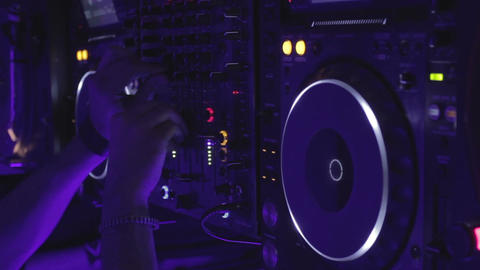 DJ switching controls on modern sound board, mixing music in night club, party Footage