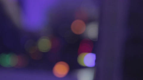 Defocused silhouette of male DJ playing music at night club. Lifestyle. Party Footage