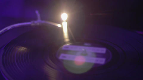 Retro turntable. Vinyl record spinning. DJ performing music in the night club Footage