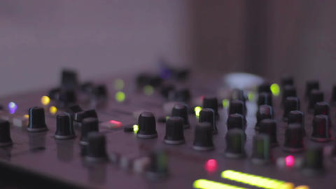 Audio equipment. DJ pushing mixing console buttons, mixing. Party atmosphere Footage