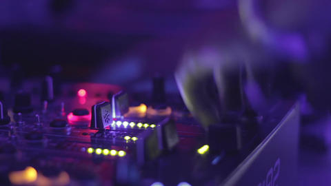 Close-up video of female dj hands playing music at the nightclub. Mixing console Footage