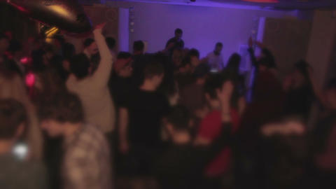 Happy crowd dancing and having fun in the nightclub. Cool party. Euphoria Footage