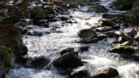 Mountain stream in sunlight flowing over rocks, sound Footage