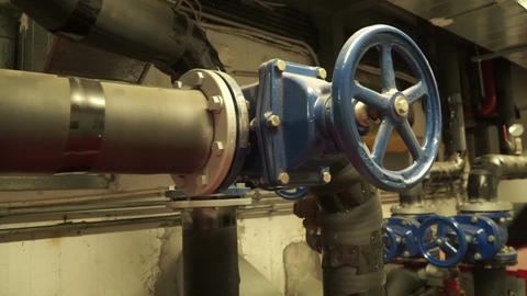 industrial heat pipes and valves in large building Footage