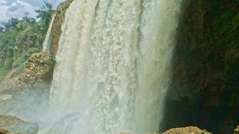Closeup Foamy Wall of Wide Powerful Waterfall among Rocks Stock Video Footage