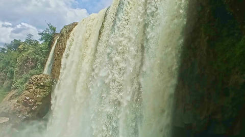 Closeup Foamy Wall of Wide Powerful Waterfall among Rocks Footage