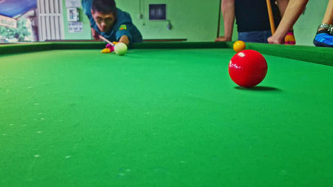 Closeup Guys Play Game of Billiards Green Table Red White Balls Footage