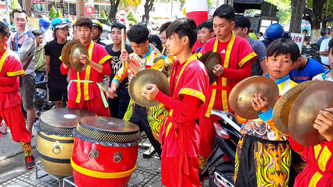 Schoolboys in Red Play Drums and Cymbals in Street Vietnam Footage