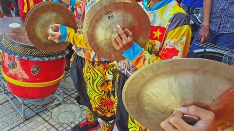 Closeup Schoolboys in Red Play Cymbals in Street Vietnam Footage