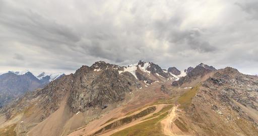 Clouds over snowy peaks. Talgar Pass, Chimbulak. Almaty. Kazakhstan Footage