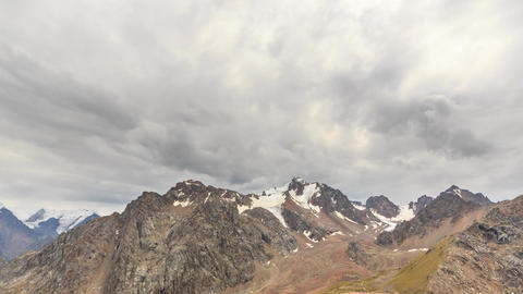 Clouds over snowy peaks. Time Lapse. Chimbulak. Almaty. Kazakhstan. TimeLapse Footage
