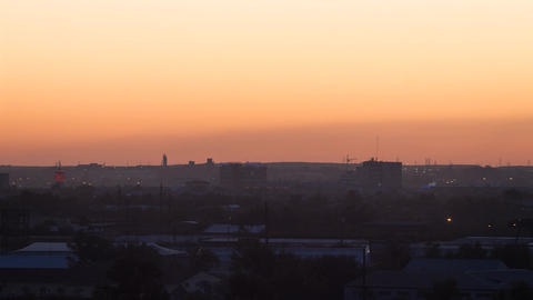 Sunset over the industrial city. Sun close-up. Karaganda, Kazakhstan. Time Lapse Footage