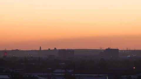 Sunset over the industrial city. Sun close-up. Karaganda, Kazakhstan. Panorama.  Footage