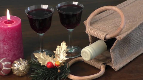 Red wine, ornaments and candles as a New Year decoration Footage